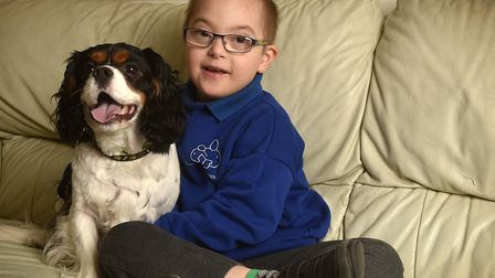 Kian Long, 7, pictured with his dog Charlie.Picture: ANTONY KELLY