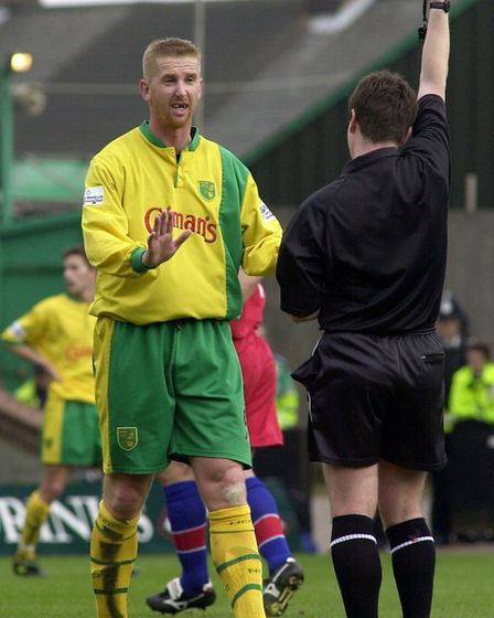 Iwan Roberts collects a yellow card during a game against Grimsby in 2001. Picture: Archant