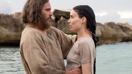 Joaquin Phoenix as Jesus Christ and Rooney Mara as Mary Magdalene. Photo: Universal Pictures