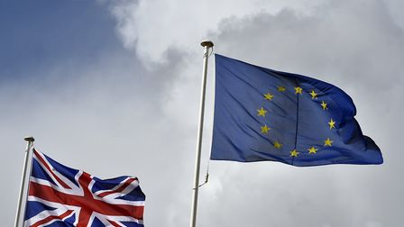 Union flag flutters next to the EU flag. Photo: Toby Melville/PA Wire