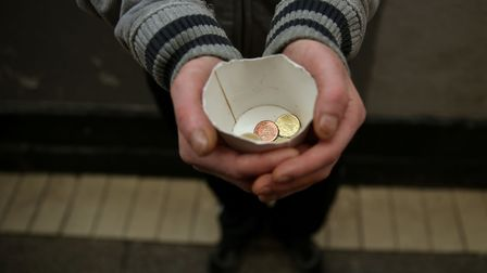 A homeless man begging. (Brian Lawless/PA Wire)