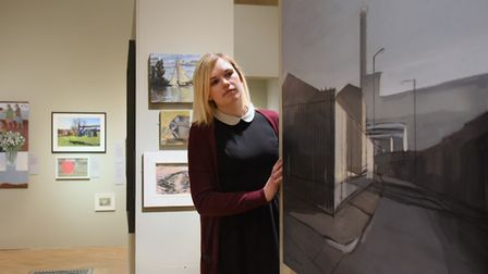 Paris Agar, exhibition curator, with some of the exhibits in the Open Art Show in Norwich Castle 'In