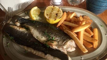 Lemon and parsley sea bass, served with fries, at Middletons, Norwich. Photo: Lauren Cope