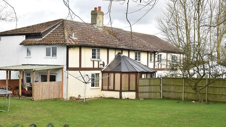 The home in East Tuddenham is on land split into two separate ownerships. Photo: Archant