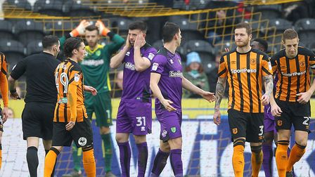 The Norwich players look stunned as Referee Tim Robinson awards a 2nd penalty to Hull possibly for a