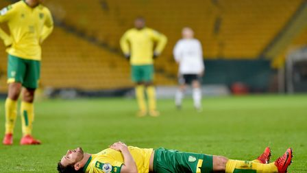 Matt Jarvis went down injured after 20 minutes of his comeback at Carrow Road. Pictures: Nick Butche