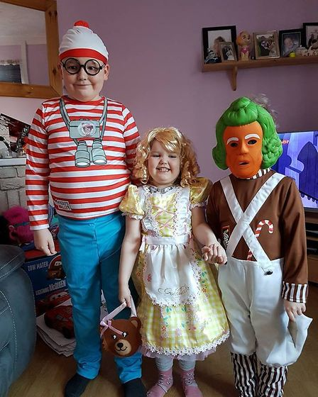 Josh Day, aged 9 with Jasmine, aged 4, and Thomas, aged 5, dressed as Wally, Goldilocks and an Ompa