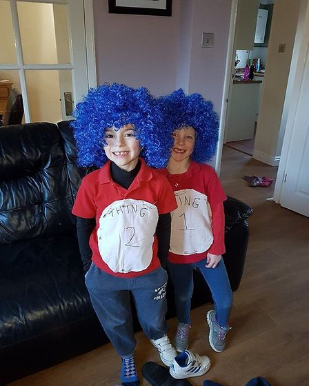 Twins Holly and Finley, aged 6, dressed up as Thing 1 and Thing 2 for a Dr Seuss themed World Book D