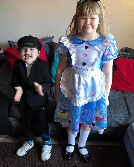 Joshua Linnell-Gunton, aged 3, dressed as the conductor from the Polar Express with Chloe, aged 7, a