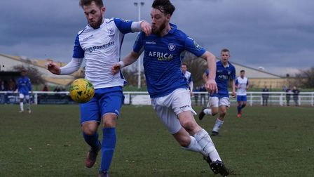 Rory McAuley battles for possession against Enfield. Picture: Shirley D Whitlow