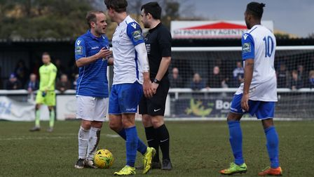 Lowestoft Town's Andrew Fisk has a wroed with referee Hallam Cutmore at Enfield. Picture: Shirley D
