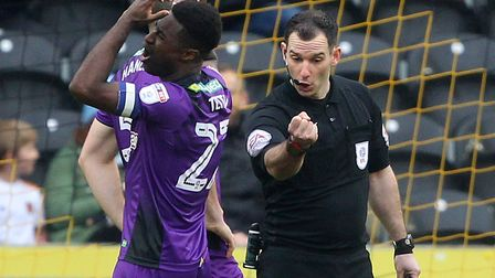 Alex Tettey reacts as referee Tim Robinson awards one of four penalties during Norwich City's 4-3 de