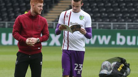 Harrison Reed and James Maddison take in the matchday programme ahead of Norwich City's clash at Hul