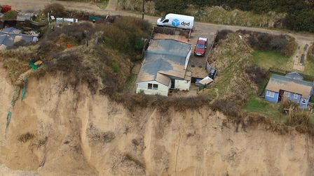 A house in The Marrams, Hemsby, perilously close to oblivion . Photo: Mike Page