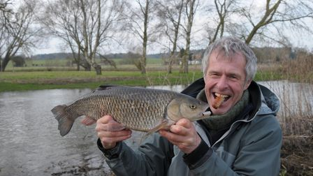 John Bailey with his last-gasp chub... and the sausage that caught it. Picture: John Bailey