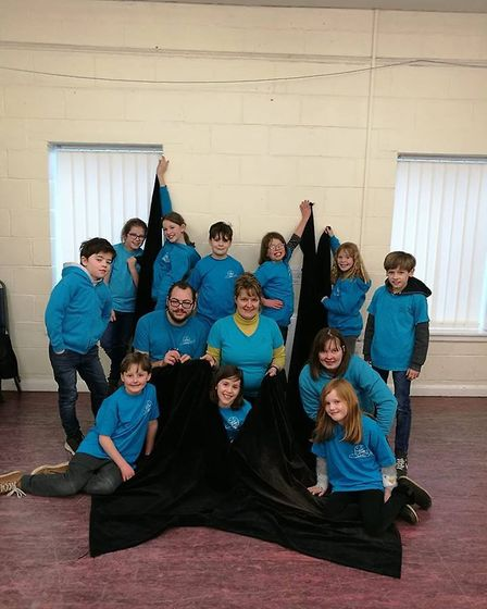 Slow Theatre Company shows off their new stage curtains. PICTURE: Lucy Findlay.