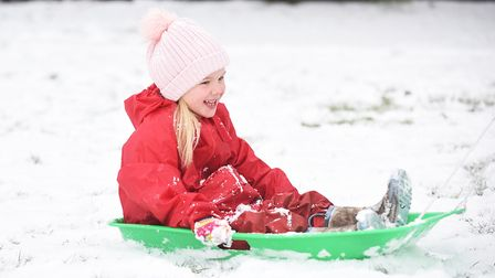 Birthday girl Elsie-May Collison (6) having fun in the snow at South Wootton Infant School. Picture: