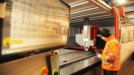 Ash Reddington operating the new laser cutting machine at Optima Stainless in King's Lynn. Picture: