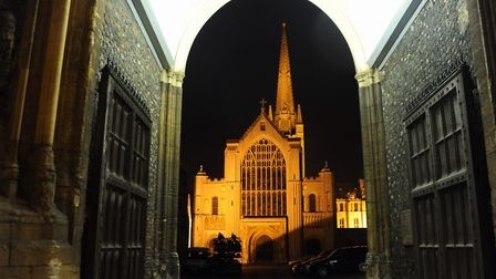Norwich Cathedral stands out against the night sky viewed through the Erpingham Gate. Picture: DENIS