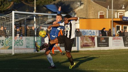 Jake Reed puts in a challenge in the recent game against Tooting & Mitcham. Picture: Shirley D Whitl