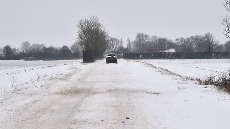 Winds blow snow onto roads surrounding Attleborough, old Buckenham and on the way to Diss making som