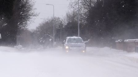 Snow is blown across Norwich Common at Wymondham as Storm Emma hits Norfolk. Picture: DENISE BRADLEY