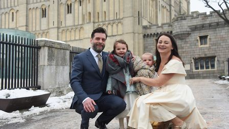 Jodie and Dan Goldsmith, newly married at Norwich Castle in a snowy wedding, with their daughters, C