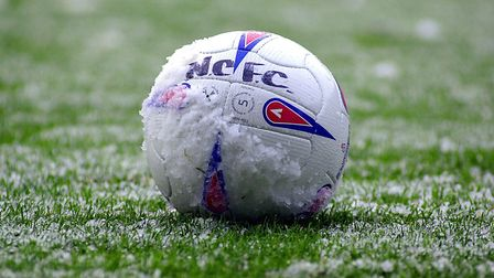 (5of14) Pic for EDP Sport - A ball in the snow on the pitch at Carrow Road, during the power cut.Pic