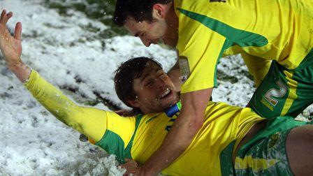 It's not always bad! Grant Holt celebrates in the snow after scoring City's second goal at Coventry'