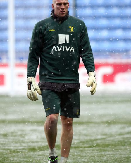 The loneliness of the goalkeeper - John Ruddy 'warms up' in the snow at Coventry in December, 2010.