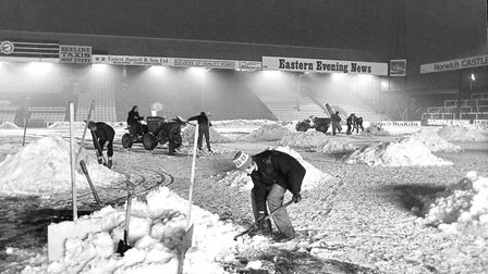 Groundsmen work to clear the snow from Carrow Road in December, 1981. Picture: Archant