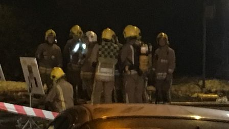 Firefighters tackling house fire in Ipswich Road area. PIC: Dan Grimmer