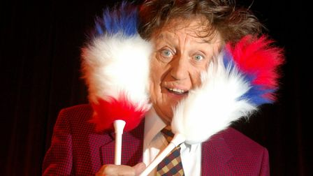 Sir Ken Dodd with a birthday cake presented to him by the Lowestoft Journal before his show at the M