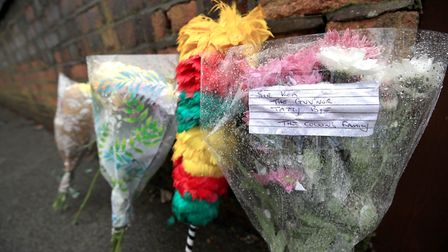Floral tributes outside the Liverpool home of comedy legend Sir Ken Dodd who has died aged 90. PRESS