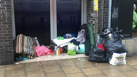 Sleeping bags and rubbish abandoned in a doorway on Davey Place. Picture: Archant