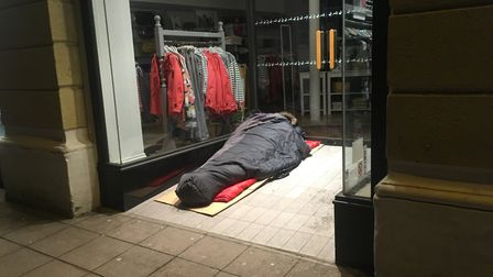 A rough sleeper in a Norwich shop doorway. Picture: Archant