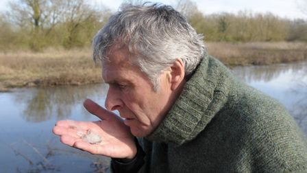 John Bailey scenting some chub scales found on the bank. When they are fresh, you can actually smell