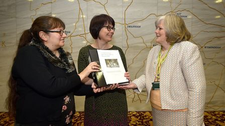 Jessica Kibble, left, and Claire Clarke, middle, hand a petition to save Morley House Respite Unit t
