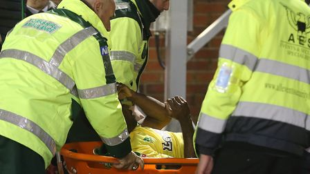 Alex Tettey is stretchered off at Oakwell.