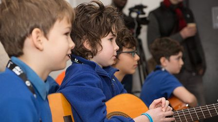 Children learning musical instruments at a previous Trinity on Tour Rock and Pop experience. The eve