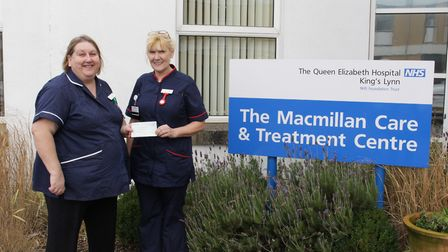 Matron Dawn Slack receives the cheque from practice development nurse Ragna Page, who has thanked th