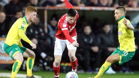 Harrison Reed, left, and Moritz Leitner of Norwich chase Forest forward Joe Lolley during the Sky Be