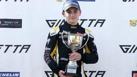 Harry King on the Ginetta junior podium at Knockhill last year after taking victory for Norfolk squa