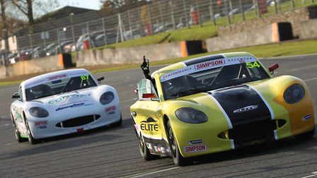 Adam Smalley celebrating victory with gave him the Ginetta Junior Winter Championship title for Norf