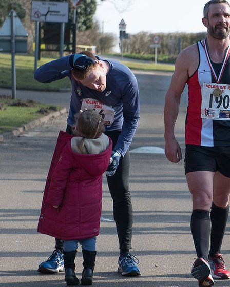 Mark Armstrong gives his medal to his daughter, Lara. Picture: Alison Armstrong