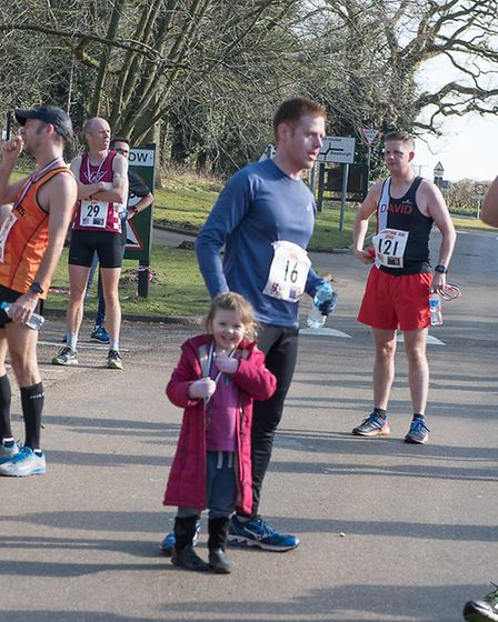 Mark Armstrong gives his medal to daughter, Lara, who's delighted with it. Picture: Alison Armstrong
