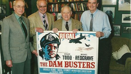 Three of the Wymondham Regal group with Richard Todd and The Dam Busters' poster at his home near Gr