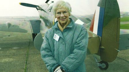 Forties film star Muriel Pavlow with a Spitfire at Duxford IWM on her return visit to the region to