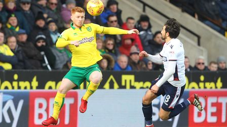 Harrison Reed of Norwich and Jem Karacan of Bolton Wanderers in action during the Sky Bet Championsh