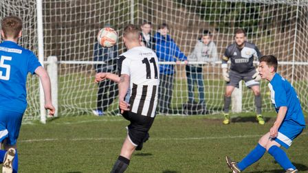 Swaffham's Joe Jackson scores his second of the afternoon against Cornard. Picture: Eddie Deane
